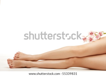 Beautiful legs of young woman over isolated white background