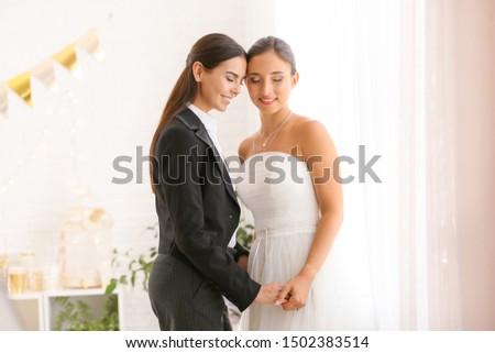 Beautiful lesbian couple during wedding ceremony #1502383514