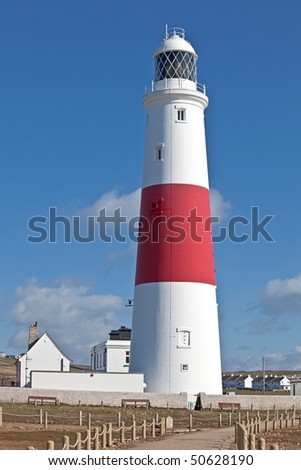 Beautiful light house by Portland Weymouth in Dorset England background in blue sky