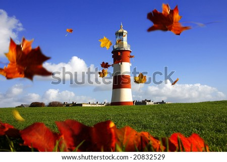 beautiful lighthouse with flying autumn  leaves
