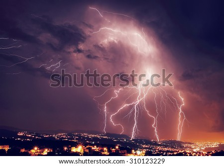 Beautiful lightning over night city, amazing nighttime panorama, powerful bright zipper, stormy weather, power of nature concept