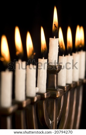 Beautiful lit hanukkah menorah on black.  Super black background.  Carefully spotted and retouched.