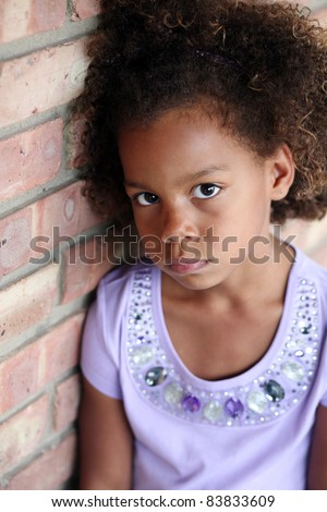 beautiful little african-american girl in natural light