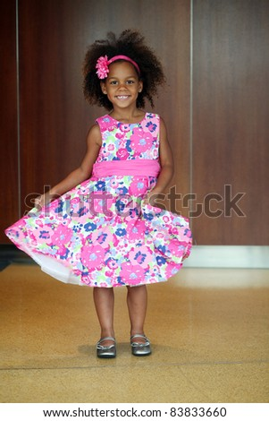beautiful little african-american girl modeling a floral dress