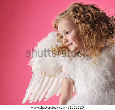 Beautiful little angel girl isolated on pink background - stock photo