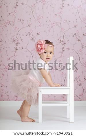 Beautiful little ballerina dressed in pink tutu
