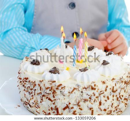 Beautiful little boy celebrates birthday. Isolated on white background