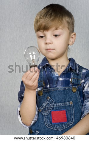 Beautiful little boy with electro light bulb