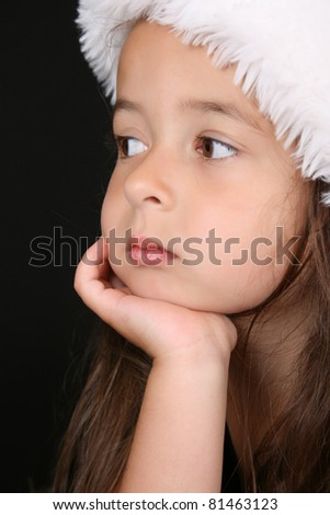 Beautiful little brunette girl dreaming about christmas