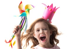 Beautiful little candy princess girl in crown holding pinwheel and smiling