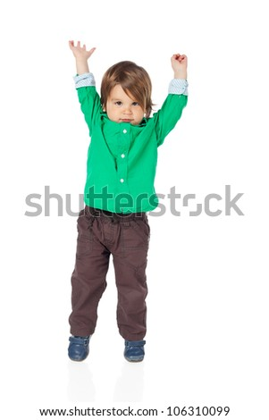 Beautiful little child, 2 years old boy, with hands up in the air, wearing shirt and jeans. High resolution image isolated on white background with copy space. Studio shot. - stock photo