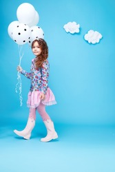 Beautiful little cute girl smile long dark hair take balloons wear style fashion silk cotton dress spring mood children clothing childhood daughter pretty face collection sister friend happy fun