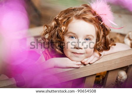 Beautiful little girl, a child on the farm