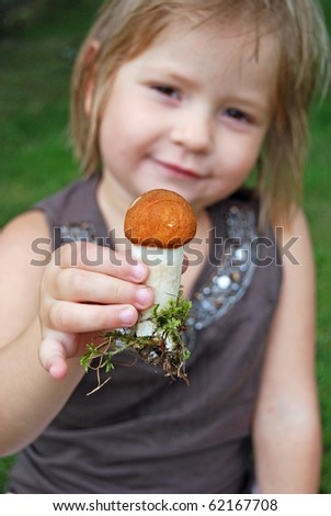Beautiful little girl and little mushroom