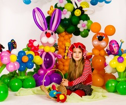 Beautiful little girl as red Riding Hood in balloon forest with balloon flower