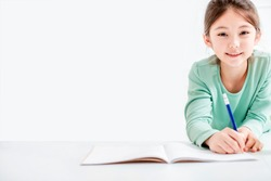 beautiful  little girl drawing and do homework on the flloor