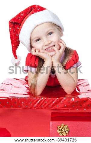Beautiful little girl dressing in Santa's Helper hat with big red gift over white