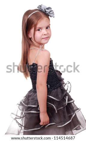 Beautiful little girl in a gray evening dress/Pretty little girl in an evening dress - stock photo