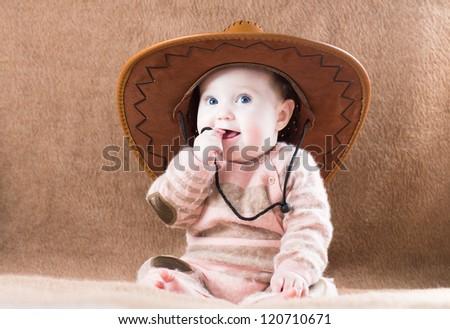 Beautiful little girl in a huge cowboy hat