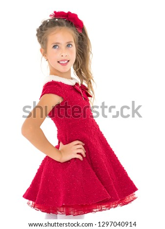 6b9e91f187 Beautiful little girl In a red dress. close-up. The concept of beauty