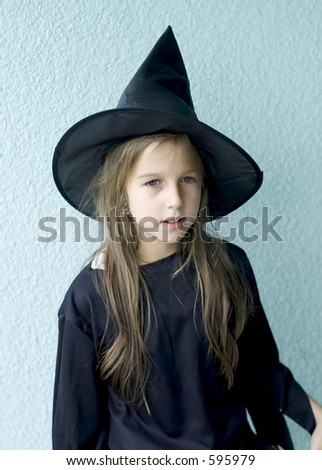 Beautiful little girl in a witch outfit