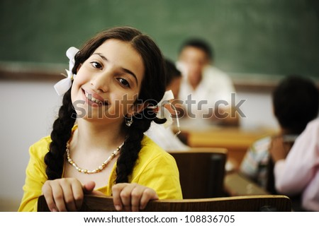 Beautiful little girl in classroom