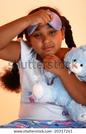 Beautiful little girl in pajamas.