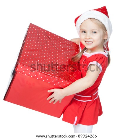 Beautiful little girl in Santa's Helper hat holding big red gift over white