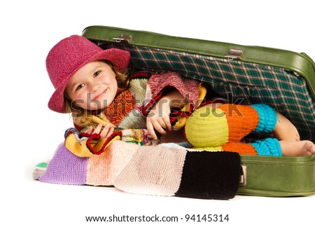 Beautiful little girl in suitcase isolated on white