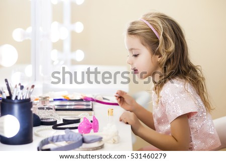 beautiful little girl in the mirror preening. little beauty #531460279