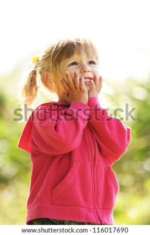 beautiful little girl on nature - stock photo