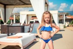 Beautiful little girl on the beach