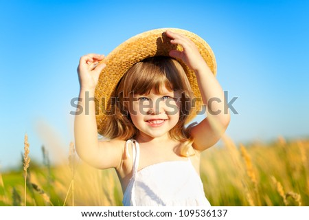 Beautiful little girl on the meadow in summer day #109536137