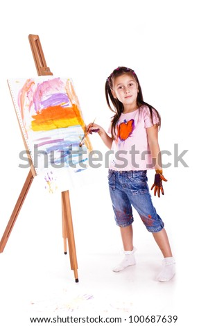 Beautiful little girl painting over white background