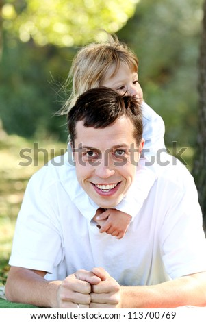 beautiful little girl play with dad in nature - stock photo