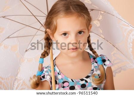 Beautiful little girl portrait with umbrella