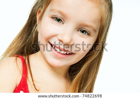 beautiful little girl smiling on a white background