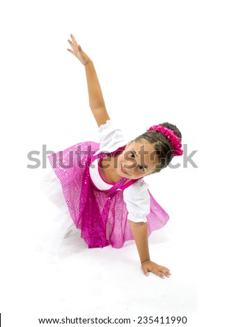 Beautiful little girl smiling with colorful dance dress