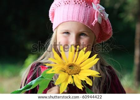 Beautiful little girl walking outdoor. Retro style. - stock photo
