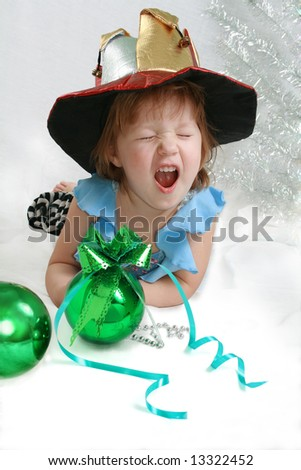 Beautiful little girl with christmas decoration green