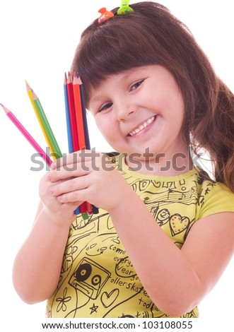 Beautiful little girl with color pencils