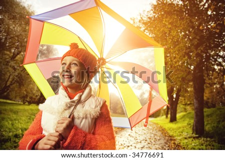 Beautiful little girl with colorful umbrella