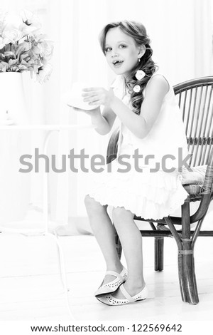 beautiful little girl with cup of tea