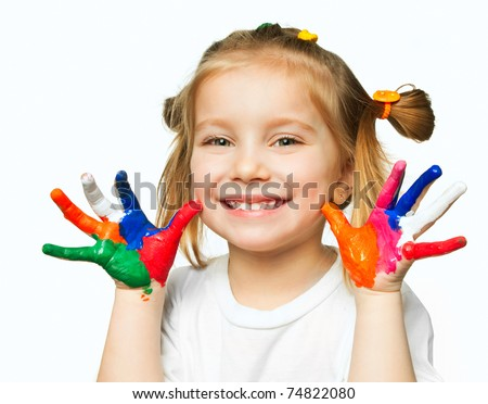 beautiful little girl with hands in the paint #74822080
