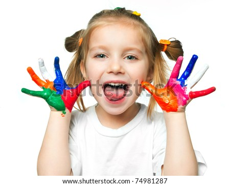 beautiful little girl with her hands in the paint