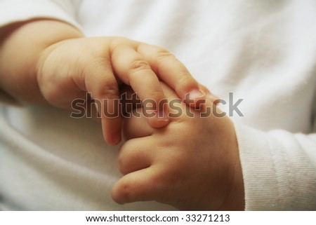 Beautiful little hands of the sleeping baby
