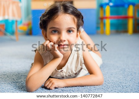 Beautiful little latin girl portrait in daycare