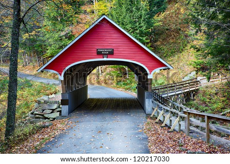 Beautiful little red covered bridge in New Hampshire during Fall season