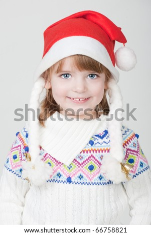 beautiful little smiling girl with blue eyes and Christmas cup
