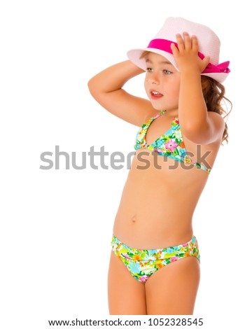 508bb71fec7 Beautiful little tanned girl in a swimsuit and a hat. The concept of summer  family